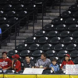 St. Louis Cardinals fans sit in the outfield during the Cardinals' baseball game against the Houston Astros on Tuesday, Sept. 25, 2012, in Houston. The Astros are moving to the American League after this season and will only face the Cardinals in interleague play.