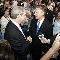 Nolan Karras and Jon Huntsman Jr. congratulate each other after the two advanced to the primary.