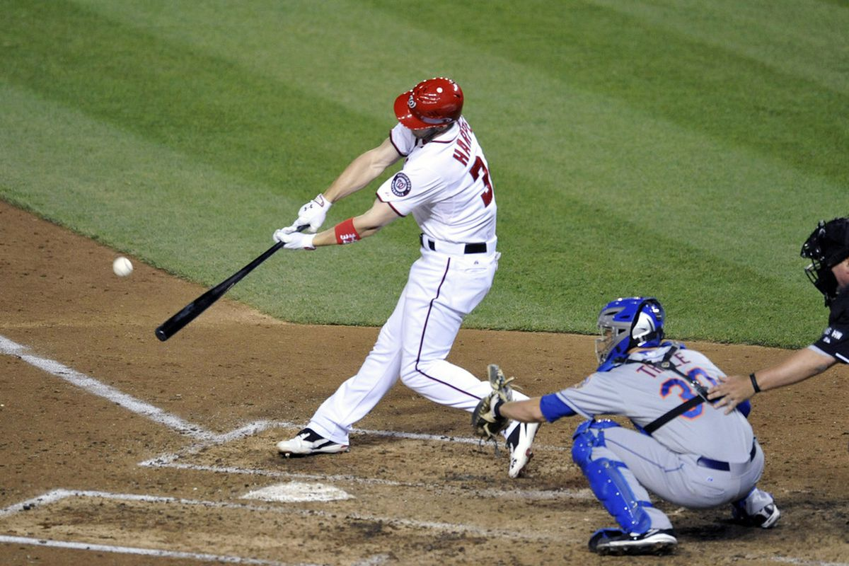 June 6, 2012; Washington, D.C., USA; Washington Nationals center fielder Bryce Harper (34) singles in the seventh inning against the New York Mets at Nationals Park. The Nationals defeated the Mets 5 - 3. Mandatory Credit: Joy R. Absalon-US PRESSWIRE