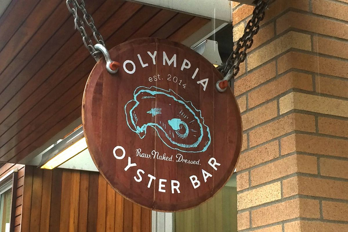 The hanging sign at Olympia Oyster Bar