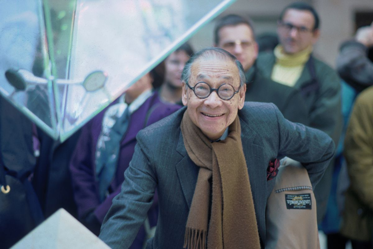 Architect I.M. Pei stands beside the tip of the Louvre's inverted pyramid in the Galleries of the Carrousel in Paris, France.