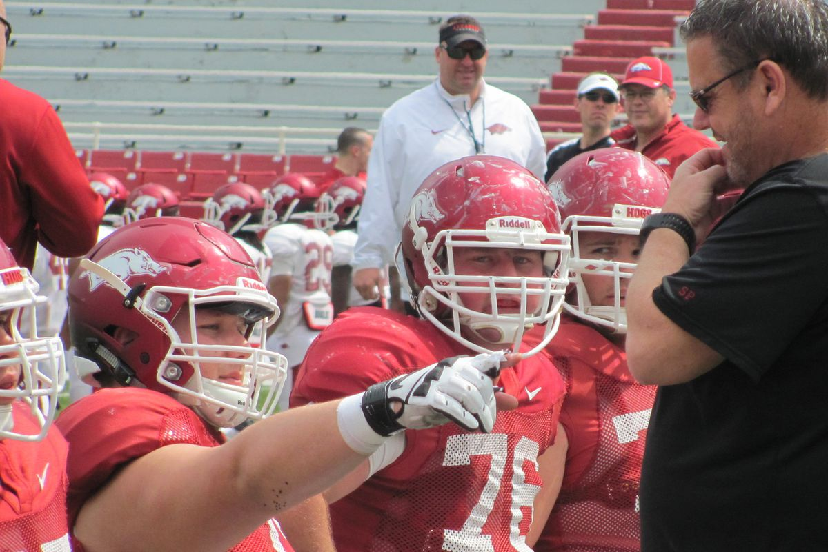 Offensive Line Coach Sam Pittman working with his players during spring practice.