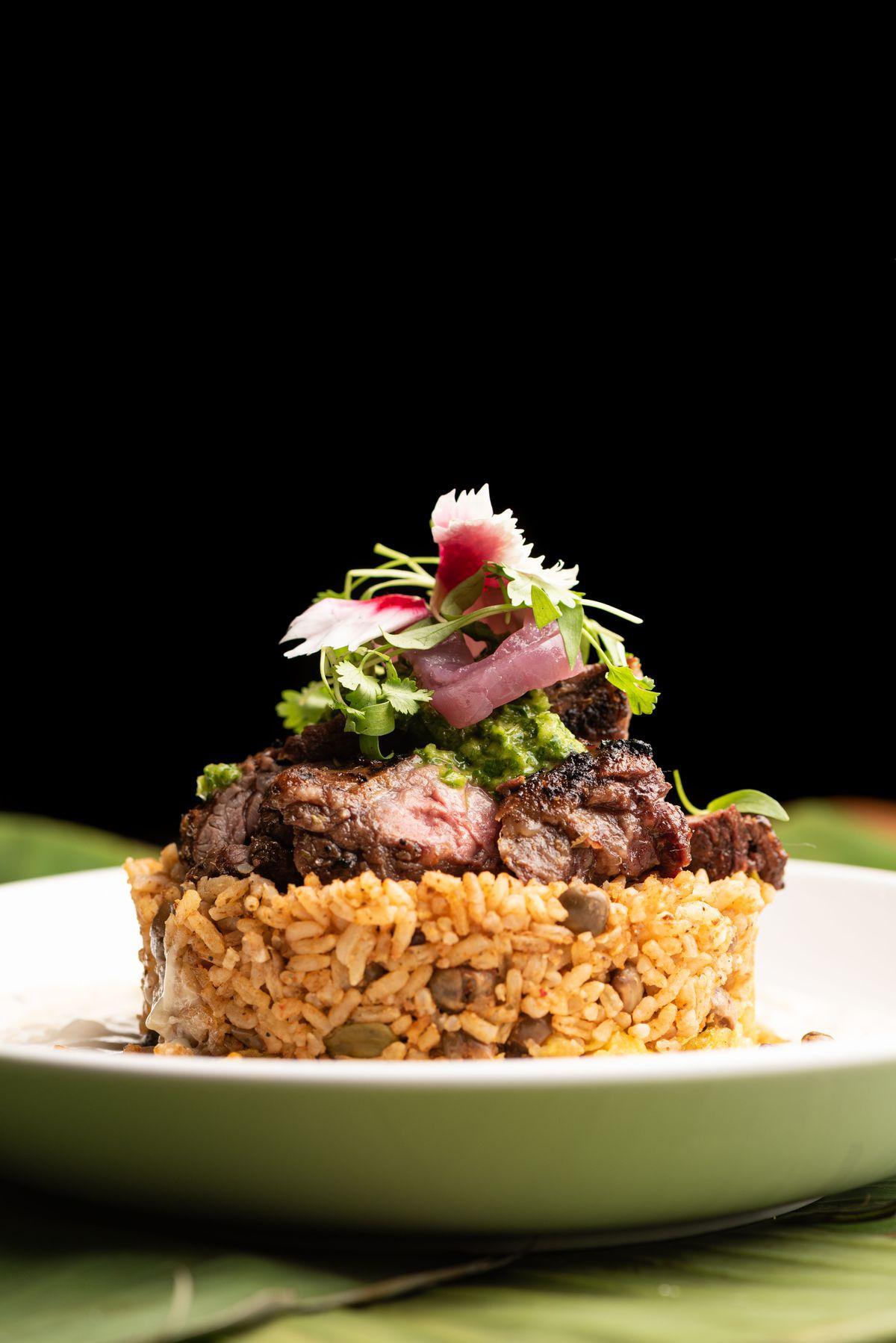 El Morro, mofongo with grilled steak, chimichurri, and truffle cream sauce.