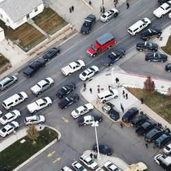 Police respond to Pleasant Grove High School during a lockdown on Thursday, Dec. 3, 2015, in Pleasant Grove. A report of a man with a gun in the building turned out to be false.