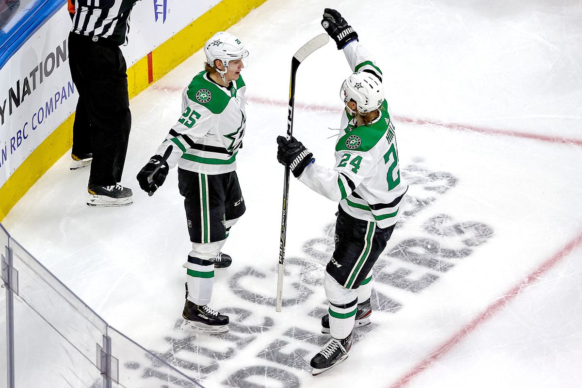 Joel Kiviranta of the Dallas Stars is congratulated by Roope Hintz after scoring a goal against the Vegas Golden Knights during the third period in Game Five of the Western Conference Final during the 2020 NHL Stanley Cup Playoffs at Rogers Place on September 14, 2020 in Edmonton, Alberta, Canada.