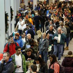 Travelers line up at Salt Lake City International Airport as flights were delayed or canceled during a snowstorm, Thursday, Dec. 19, 2013.