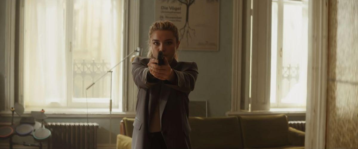 Florence Pugh holds a gun as Yelena Belova in Black Widow