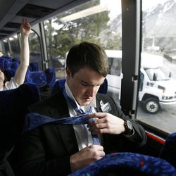 Elder John Scoggin re-ties his tie just after boarding the bus to leave the Provo Missionary Training Center of The Church of Jesus Christ of Latter-day Saints in Provo, Utah Tuesday, Feb. 15, 2011.