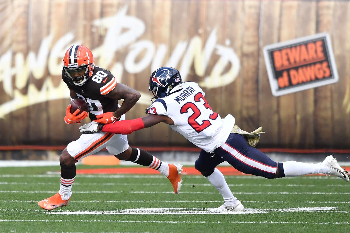 Jarvis Landry #80 of the Cleveland Browns carries the ball against Eric Murray #23 of the Houston Texans during the first half at FirstEnergy Stadium on November 15, 2020 in Cleveland, Ohio.