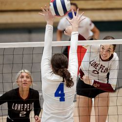 Lone Peak's Emeline Hudson hits the ball as her team and Fremont face off in a 6A volleyball state semifinals game at Hillcrest High School in Midvale on Friday, Nov. 6, 2020.