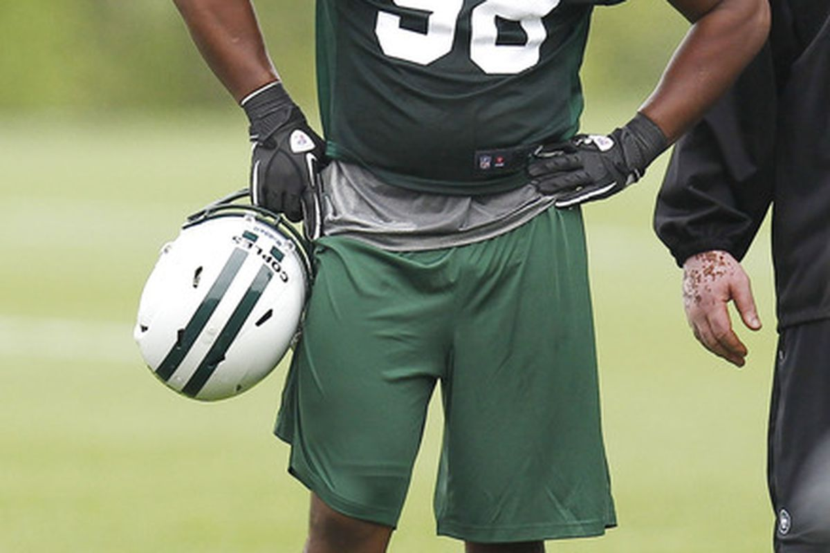 FLORHAM PARK, NJ - MAY 04:  Quinton Coples #98 of the New York Jets works out during the Jets Rookie Minicamp on May 4, 2012 in Florham Park, New Jersey.  (Photo by Jeff Zelevansky/Getty Images)