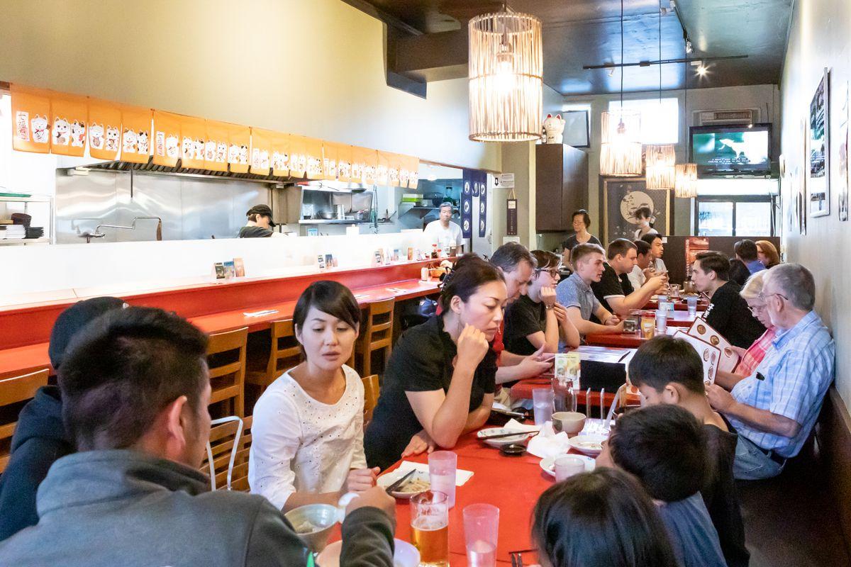 Customers seated at tables inside Yu-Raku