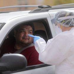Karsten Blackwater listens to instructions for his COVID-19 test outside of the Monument Valley Health Center in Oljato-Monument Valley, San Juan County, on Thursday, April 16, 2020. The Navajo Nation has one of the highest per capita COVID-19 infection rates in the country.
