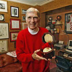 Former Utah All-American basketball player Arnie Ferrin holds his medal from the Basketball Hame of Fame Wednesday, April 1, 2009,in Salt Lake City, Utah.  Tom Smart, Deseret News