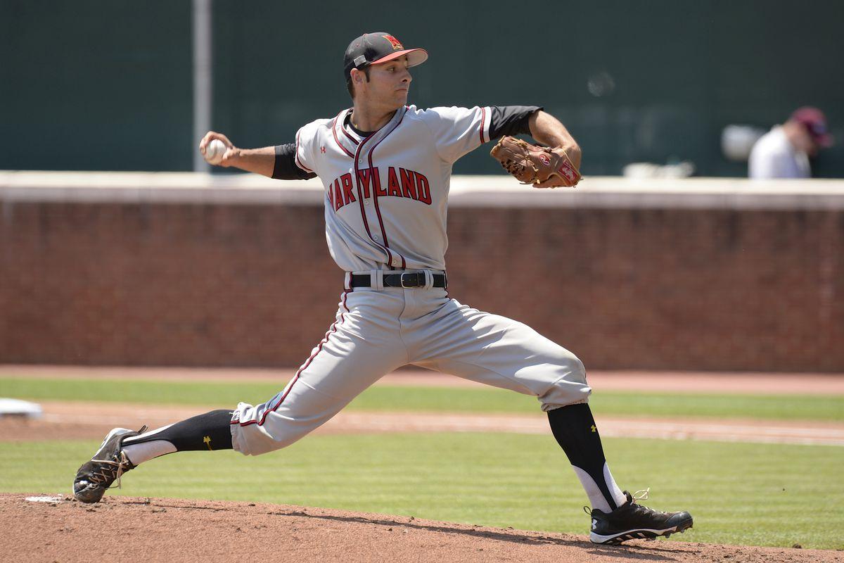 Jake Stinnett pitching for Maryland in June 2014