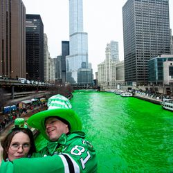 Stacey Peterson and Kevin McGuire take a selfie with the green Chicago River to celebrate St. Patrick's Day, Saturday, March 17th, 2018. | James Foster/For the Sun-Times