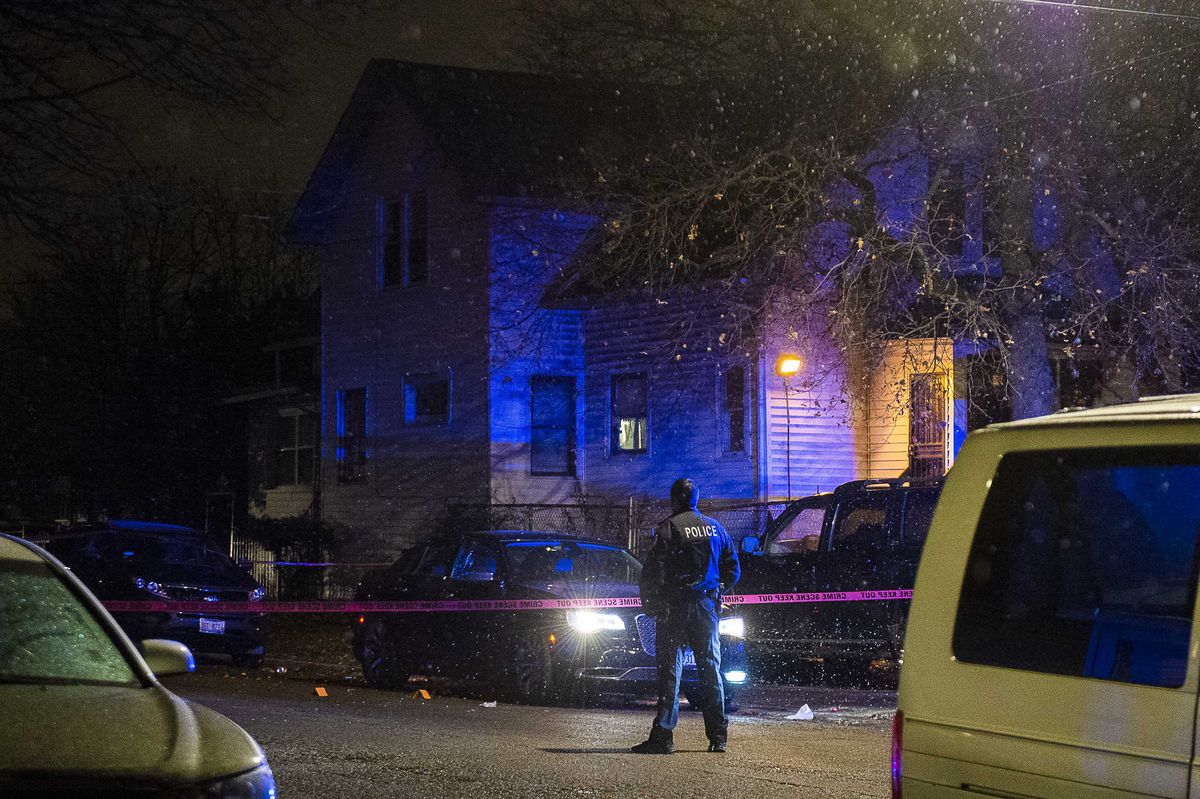 Police investigate a person shot multiple times in a car Sunday morning in the 5200 block of West Thomas Street, in the Austin Neighborhood. | Tyler LaRiviere/Sun-Times