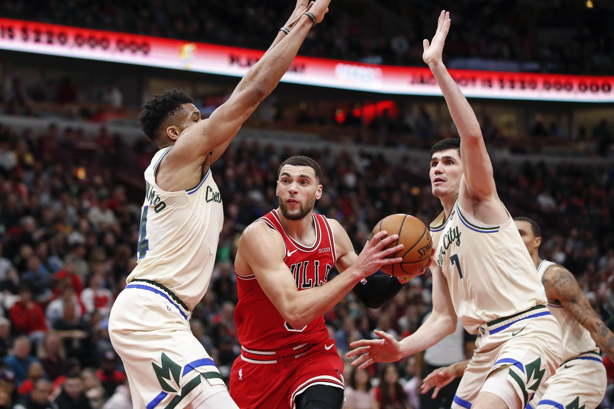 Chicago Bulls guard Zach LaVine goes to the basket against Milwaukee Bucks forward Giannis Antetokounmpo and forward Ersan Ilyasova during the second half at United Center.