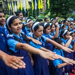 Students take an oath during the 71st Independence Day celebrations at the MIT World Peace University in Pune, Maharashtra, India, on August 15, 2017.