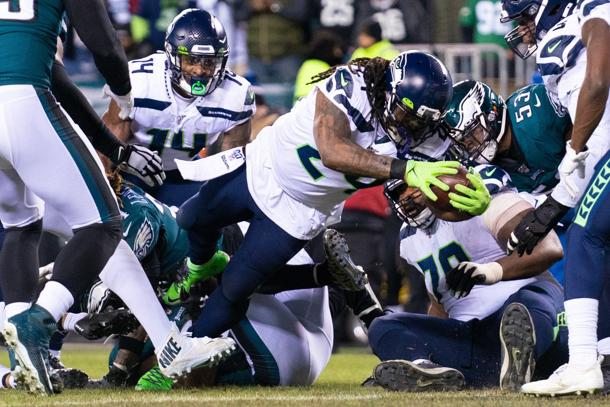 Seattle Seahawks running back Marshawn Lynch scores a touchdown against the Philadelphia Eagles during the second quarter in a NFC Wild Card playoff football game at Lincoln Financial Field