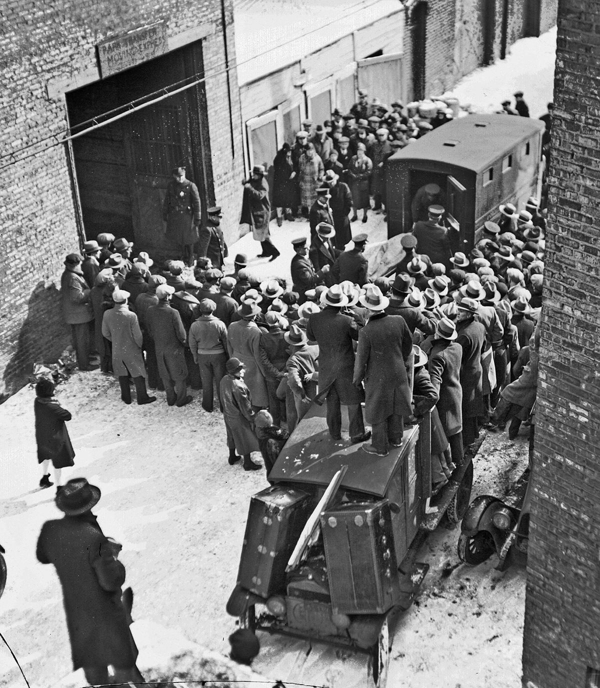 A body is removed from the S.M.C. Cartage Co. garage on North Clark Street in Chicago on Feb. 14, 1929, following the St. Valentine's Day massacre.   Chicago History Museum/Distributed by the Associated Press