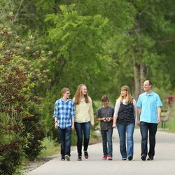 After their lesson and games Dave and Becky Evans enjoy a family walk Monday, May 11, 2015, along the Murray Parkway.