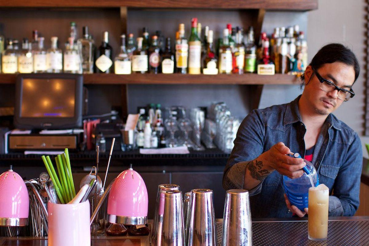 Danny Louie behind Chino's bar.