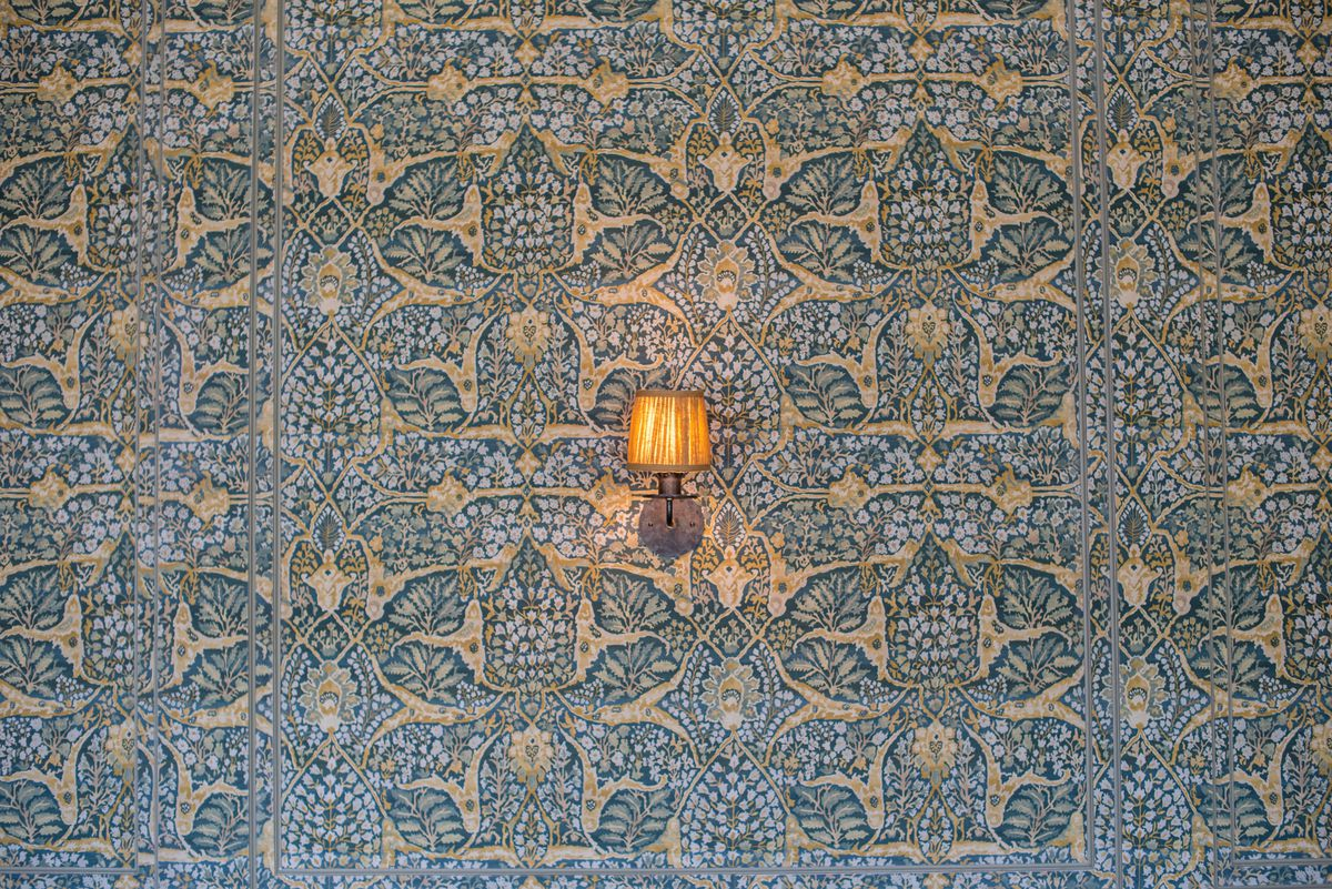 A wall light with wallpaper at A.O.C. in Brentwood, California.