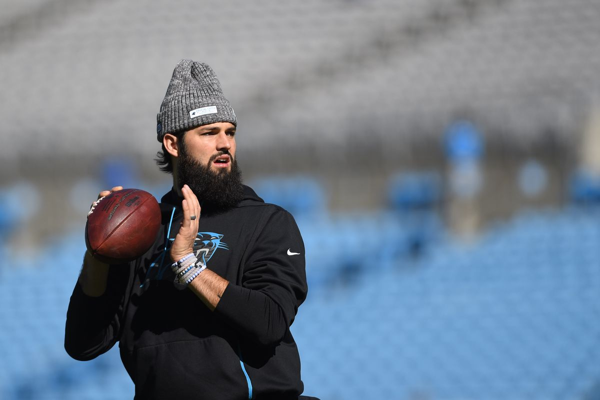 Carolina Panthers quarterback Will Grier warms up before the game at Bank of America Stadium.