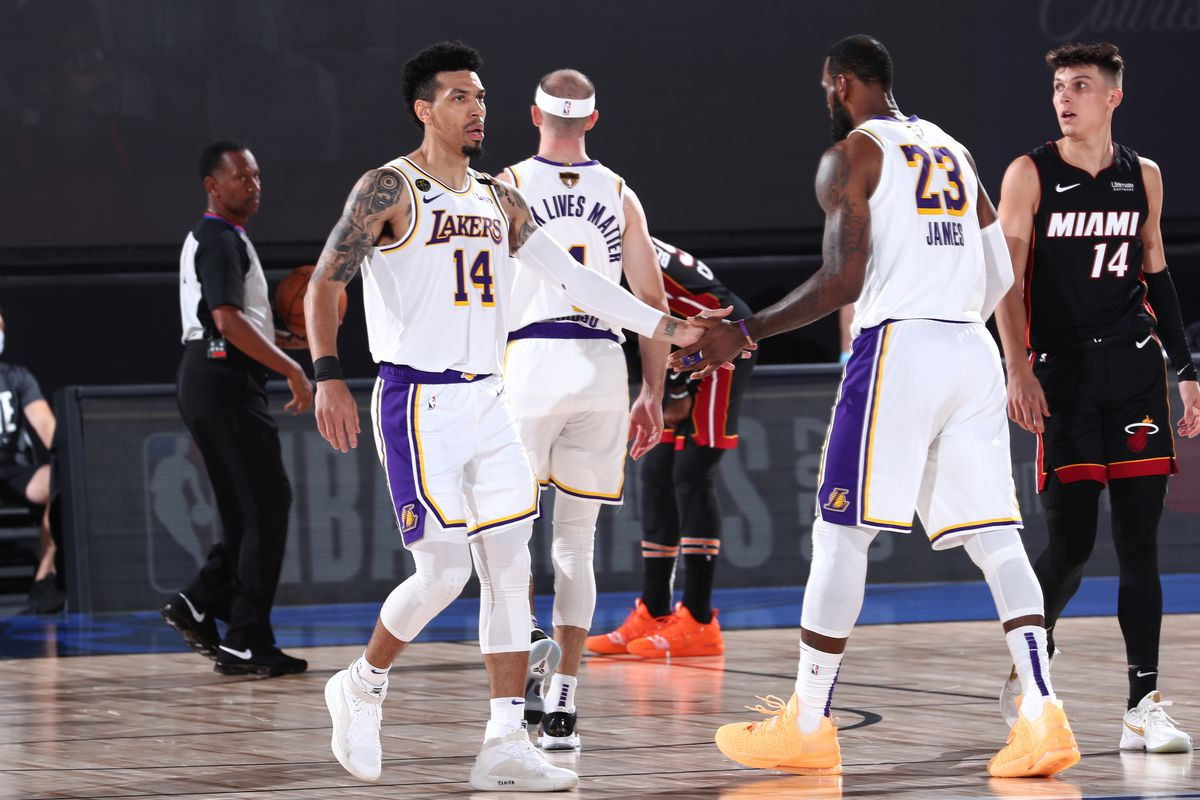 Danny Green high-fives Anthony Davis of the Los Angeles Lakers during Game Six of the NBA Finals on October 11, 2020 at AdventHealth Arena in Orlando, Florida.