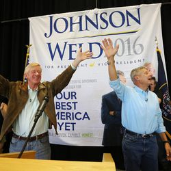 Libertarian presidential candidate Gov. Gary Johnson, right, running mate Gov. Bill Weld wave to a group of supporters at the Student Union Building at the University of Utah in Salt Lake City on Saturday, Aug. 6, 2016.