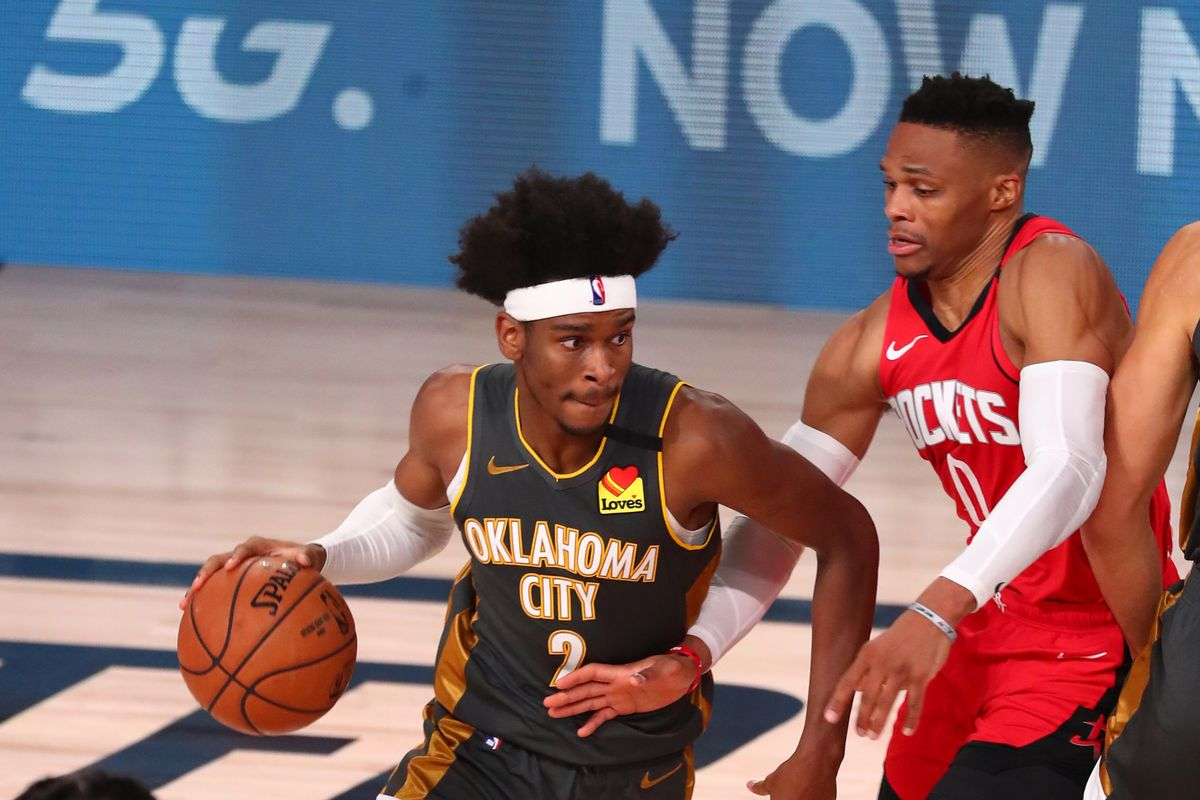 Oklahoma City Thunder guard Shai Gilgeous-Alexander drives past Houston Rockets guard Russell Westbrook during the fourth quarter in game six of the first round of the 2020 NBA Playoffs at ESPN Wide World of Sports Complex.