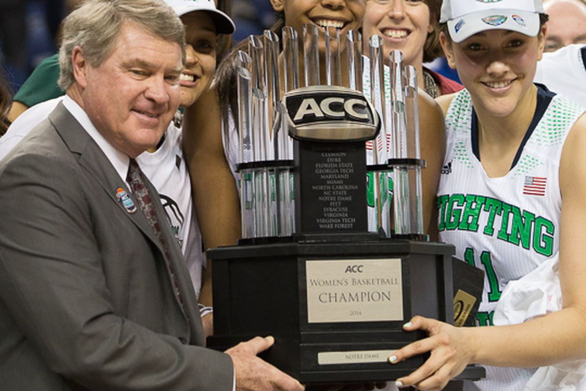 Notre Dame is presented the championship trophy by ACC Commissioner John Swofford