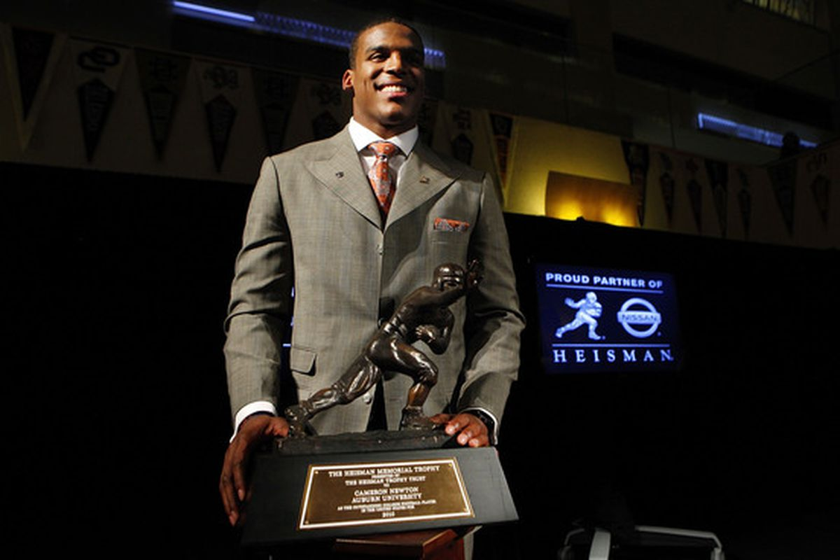 NEW YORK - DECEMBER 11:  Cam Newton quarterback of the Auburn University Tigers poses with the 2010 Heisman Memorial Trophy Award on December 11 2010 in New York City.  (Photo by Jeff Zelevansky/Getty Images)