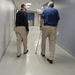 Retired Connecticut men's basketball coach Jim Calhoun, right, walks away with associate head coach George Blaney in Storrs, Conn., Thursday, Sept. 13, 2012. The 70-year-old Hall of Famer ran the men's program for 26 years and won three national titles. Assistant coach Kevin Ollie, who played for Calhoun, will be the Huskies' new coach.