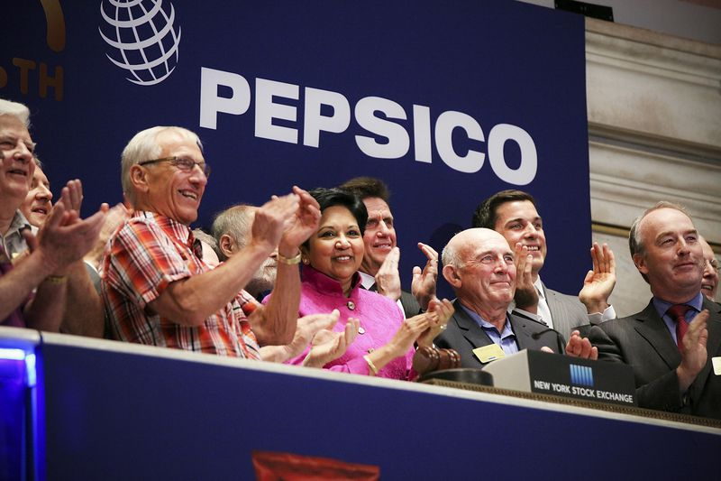Indra K. Nooyi, Chairman and CEO of PepsiCo., rings the Opening Bell with other executives at the New York Stock Exchange on June 8, 2015, in New York City.
