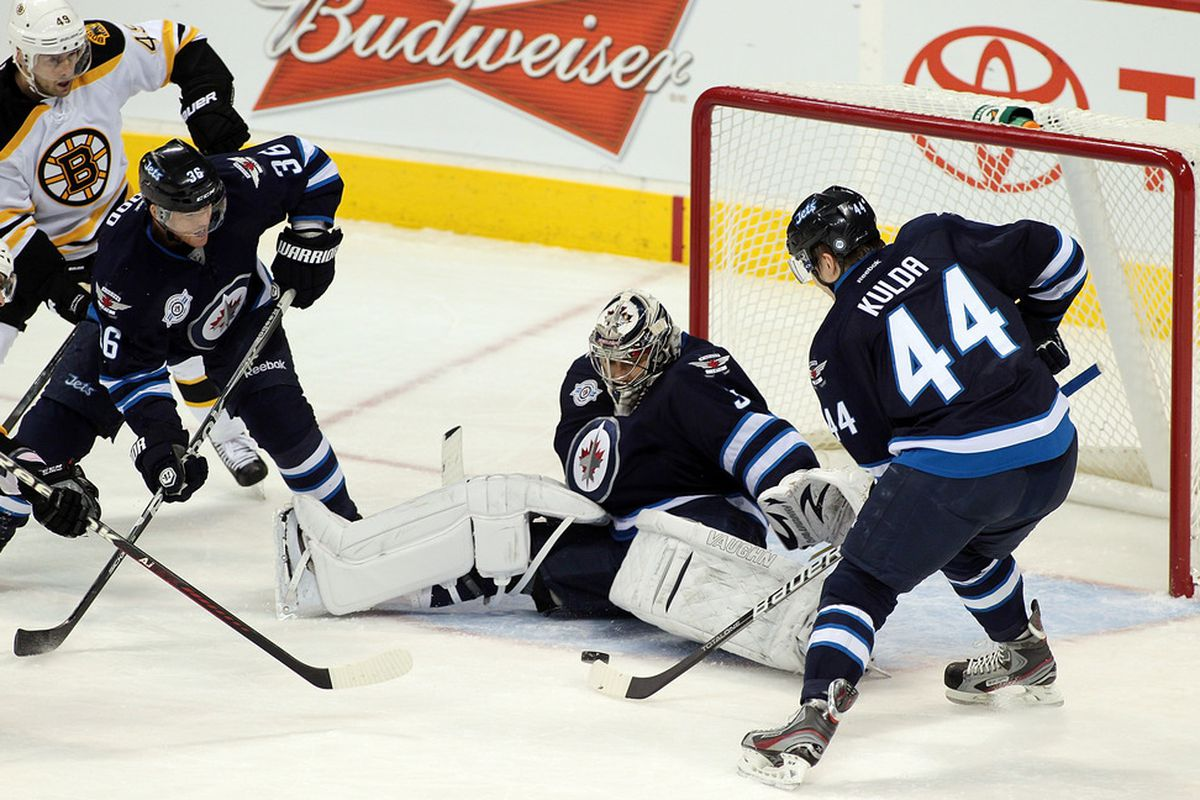 WINNIPEG, CANADA - DECEMBER 6: Ondrej Pavelec #31 of the Winnipeg Jets blocks a shot on goal by the Boston Bruins in NHL action at the MTS Centre on December 6, 2011 in Winnipeg, Manitoba, Canada. (Photo by Marianne Helm/Getty Images)