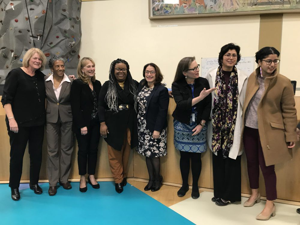 Susana Cordova, fourth from right, poses with the seven members of the Denver school board after they voted to appoint her superintendent.