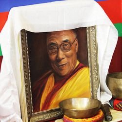 A picture of the Dalai Lama is displayed as members of the Tibetan Buddhist Temple participate in annual Prayers for Compassion celebrations in Salt Lake City Thursday, July 3, 2014. The three-day festival offers members of the Salt Lake community a chance to observe, support and participate in a beautiful round-the-clock ritual generating compassion and loving-kindness on behalf of all sentient beings.