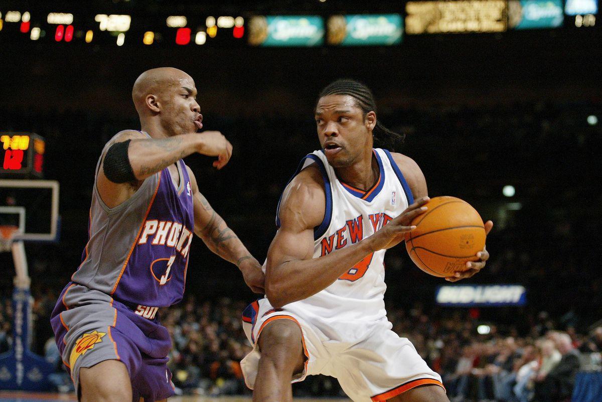 Phoenix Suns' Stephon Marbury guards New York Knicks' Latrel