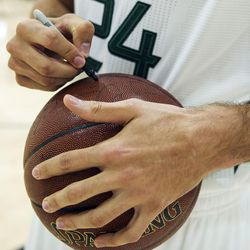 Utah Jazz center Jeff Withey signs a basketball during Media Day at Zions Bank Basketball Center in Salt Lake City on Monday, Sept. 26, 2016.