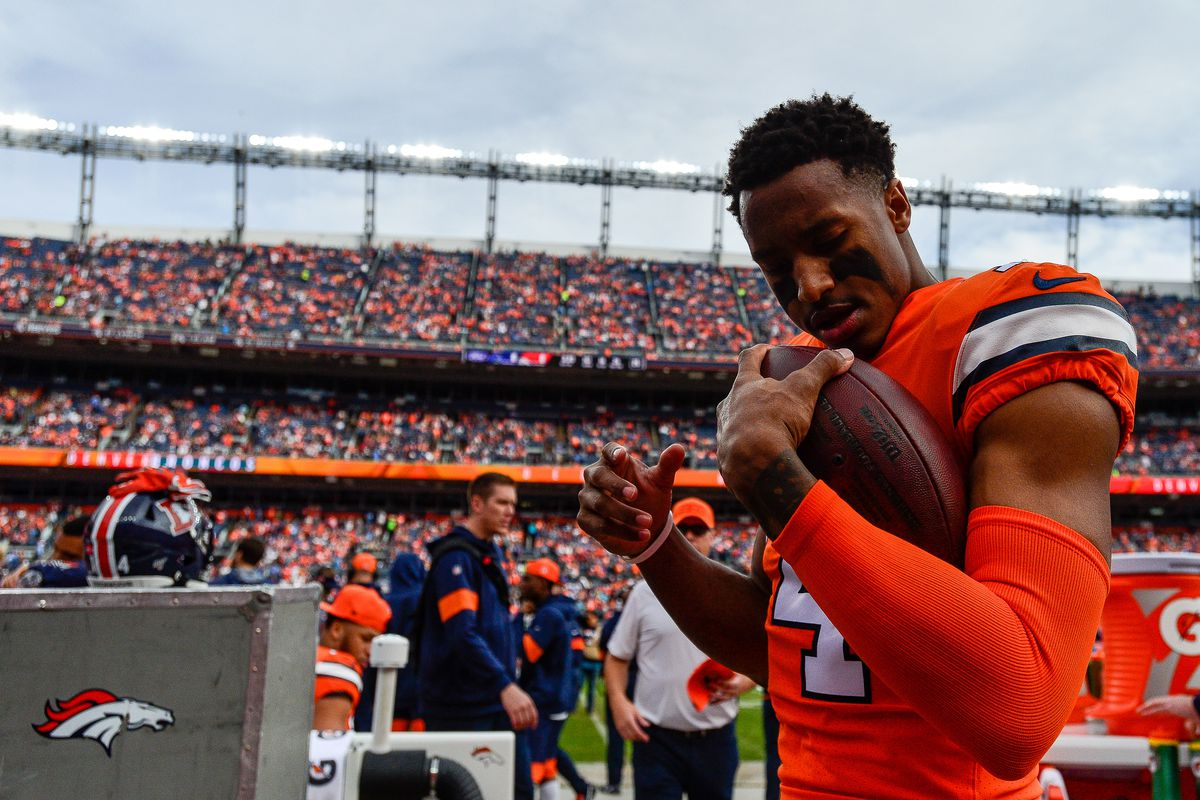 Courtland Sutton #14 of the Denver Broncos holds the ball as he warms up in the bench area before the start of a game against the Detroit Lions at Empower Field on December 22, 2019 in Denver, Colorado.