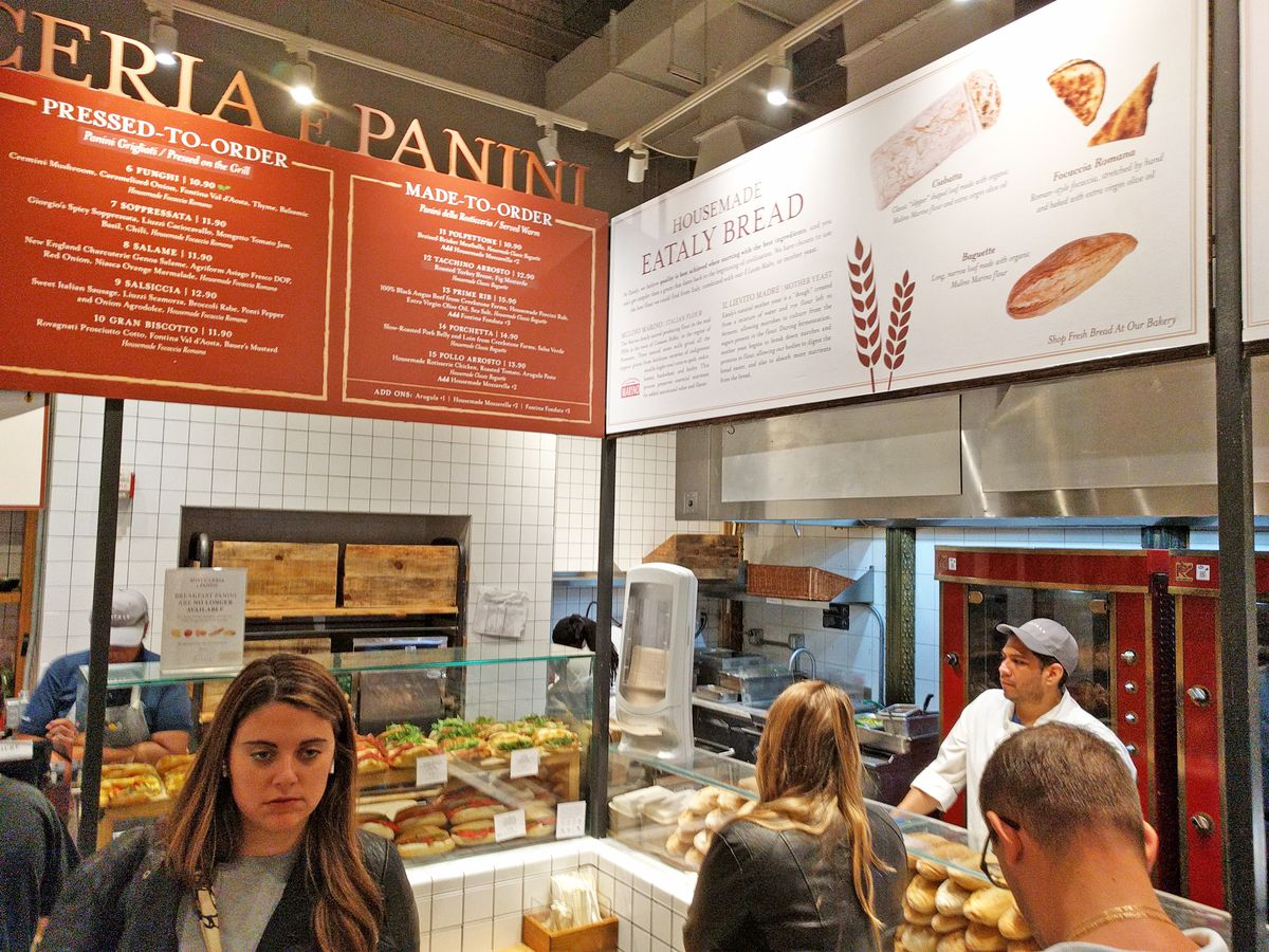 The sandwich making counter at Eataly is seen, with several customers waiting for their sandwiches...