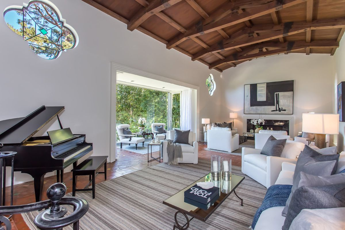 Living area with beamed ceiling