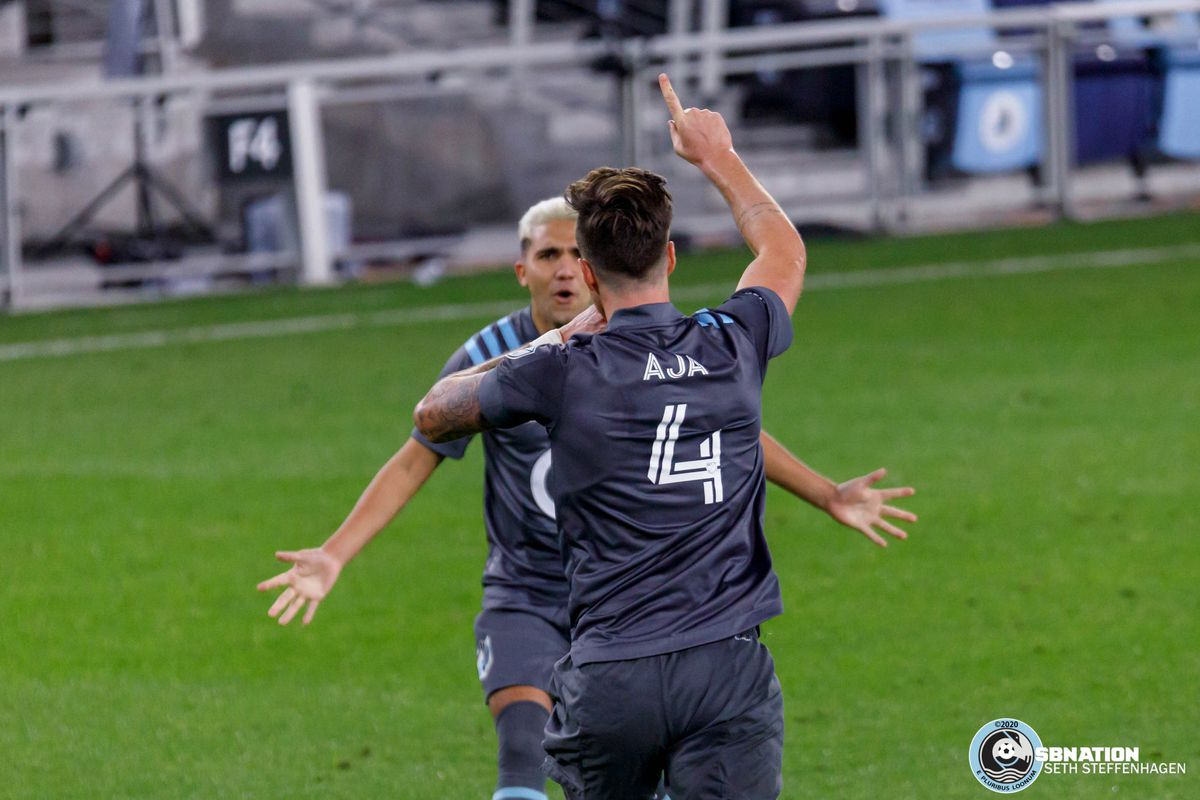 November 4, 2020 - Saint Paul, Minnesota, United States - Minnesota United midfielder Emanuel Reynoso (10) assists teammate Jose Aja (4) on a goal during the match against the Chicago Fire at Allianz Field.