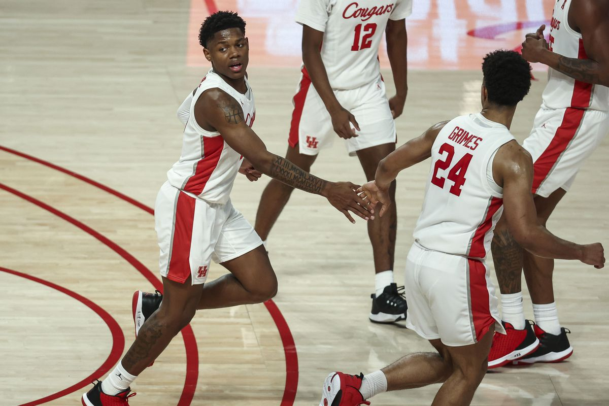 Houston Cougars guard Marcus Sasser celebrates with guard Quentin Grimes after scoring a basket against the Tulane Green Wave during the second half at Fertitta Center.