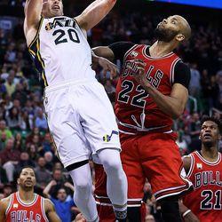 Utah Jazz forward Gordon Hayward (20) dunks the ball in overtime with Chicago Bulls forward Taj Gibson (22) defending during NBA basketball in Salt Lake City, Monday, Feb. 1, 2016.