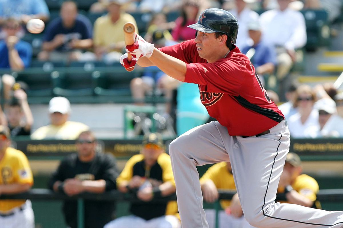 March 24, 2012; Bradenton, FL, USA; Houston Astros starting pitcher Kyle Weiland (56) bunts in the third inning against the Pittsburgh Pirates at McKechnie Field.  Mandatory Credit: Kim Klement-US PRESSWIRE