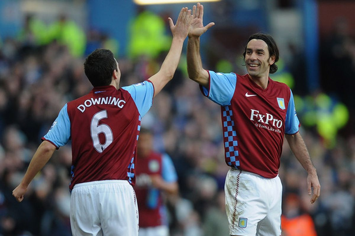 BIRMINGHAM, ENGLAND - FEBRUARY 26: Stewart Downing of Aston Villa celebrates with Robert Pires after hatching a vile plan to get the hell out of Birmingham...together.   (Photo by Laurence Griffiths/Getty Images)