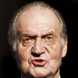 In this Dec. 27, 2011 file photo, Spain's King Juan Carlos leaves after the official opening of Parliament, in Madrid.